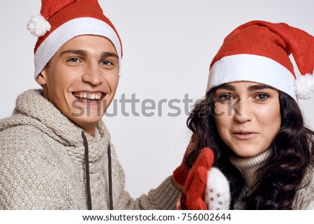 young couple in New Year's  hats, Christmas, holiday, love story