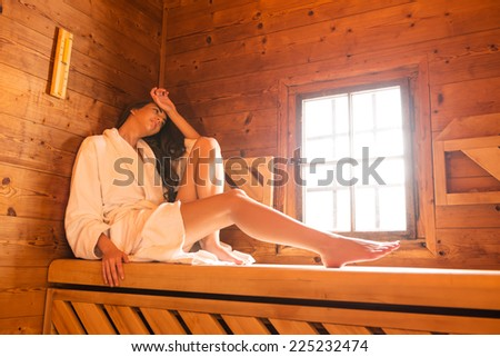Young couple in sauna - stock photo
