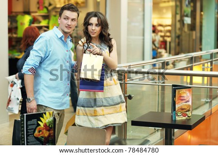 Young couple in shopping at store - stock photo