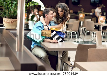 Young couple in shopping mall - stock photo
