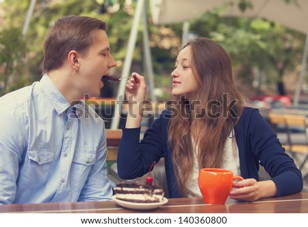 young couple in the cafe.