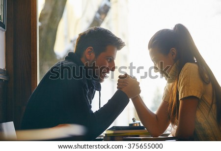 Young couple in the cafe holding their hands. - stock photo