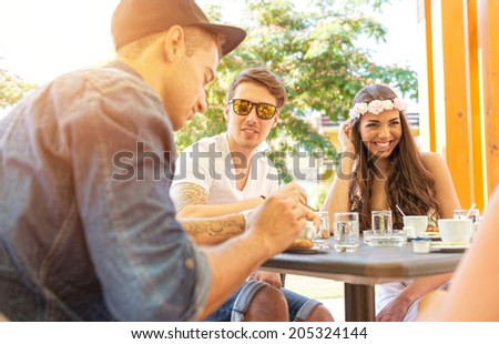 Young couple in the cafe terrace - stock photo