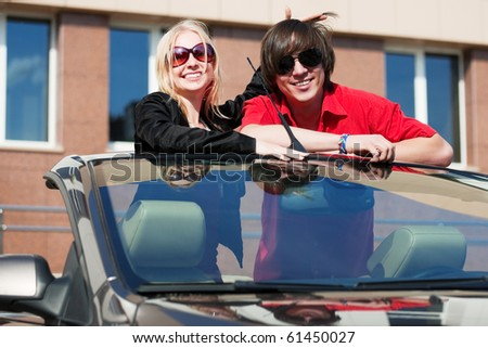 Young couple in the convertible. - stock photo