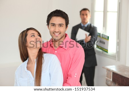 Young couple in their new house - stock photo