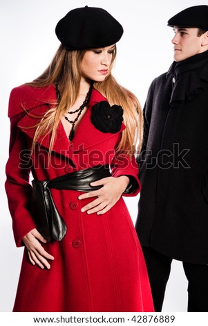 young couple in winter clothes studio on white - stock photo