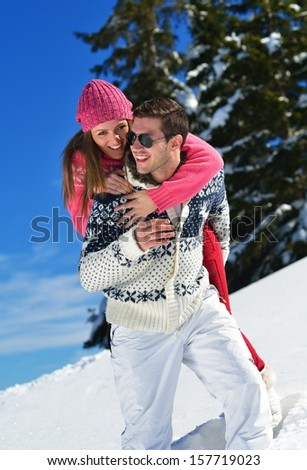 Young Couple In winter Snow Scene at  beautiful sunny day