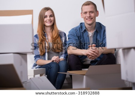 Young couple is happy because of their moving out