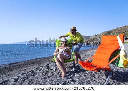 Young couple is having fun at the beach on a summer day
