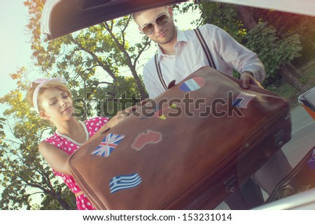 Young couple is preparing for a trip - stock photo