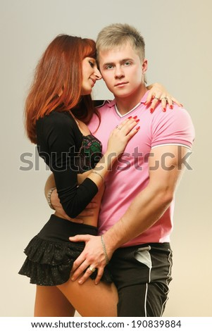 Young couple, isolated on grey background - stock photo