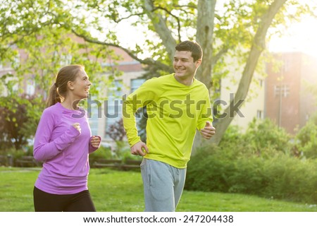 Young couple jogging - stock photo