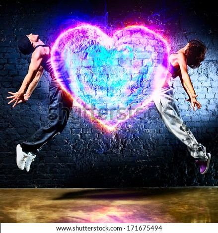 Young couple jumping to heart symbol. - stock photo