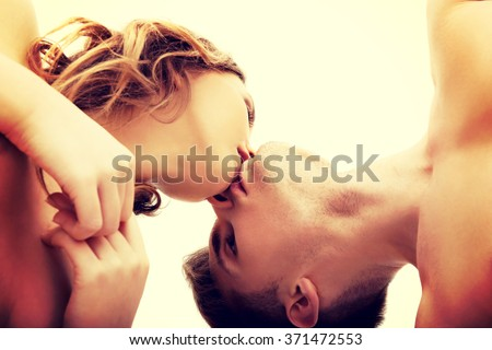 Young couple kissing.