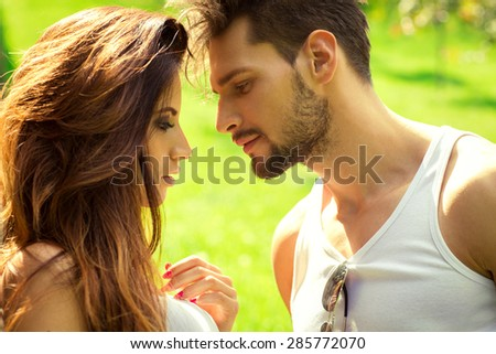 Young couple kissing each other - stock photo