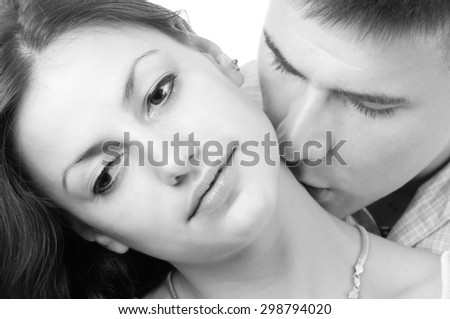 Young couple kissing isolated on white. - stock photo