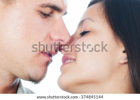 Young couple kissing isolated on white background. - stock photo