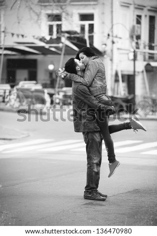 Young couple kissing on the street - stock photo