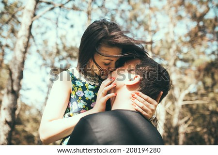 Young couple kissing outdoor in summer sun light. Kiss love date color evening teen.  - stock photo