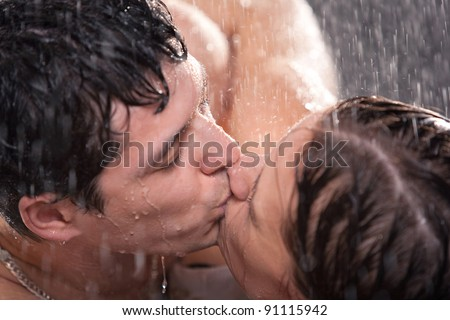 Young couple kissing portrait. Water studio photo. - stock photo