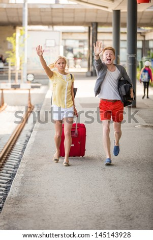 Young Couple Late at Train Station - stock photo