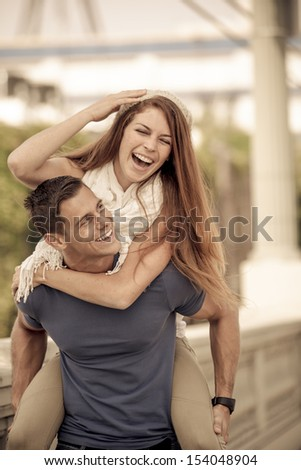 Young Couple laughing in the city of Los Angeles, California - stock photo