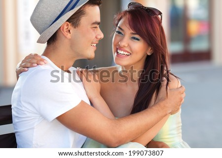 Young couple laughing in the town