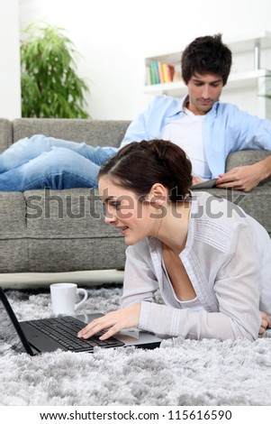 Young couple lazing about at home