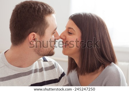 young couple looking at each other at home interior. - stock photo