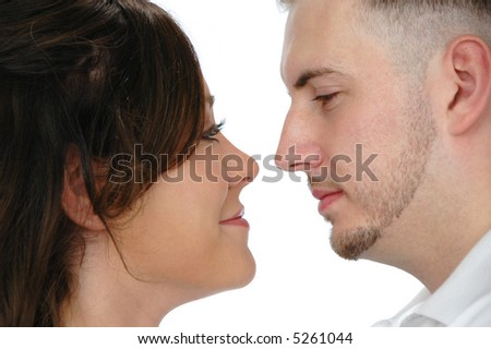 Young couple looking at each other isolated on white - stock photo