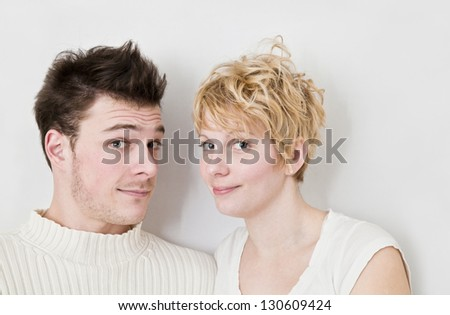 Young Couple Looking at the camera. - stock photo