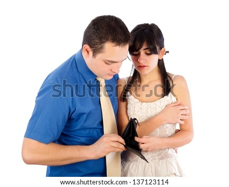 Young couple looking at their empty purse. - stock photo