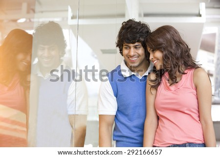 Young couple looking at window display together
