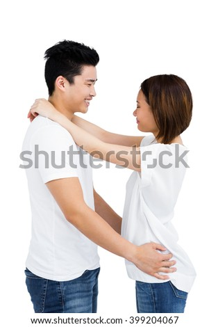 Young couple looking face to face on white background