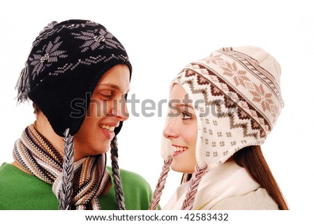 Young couple looking lovingly at each other on white background - stock photo