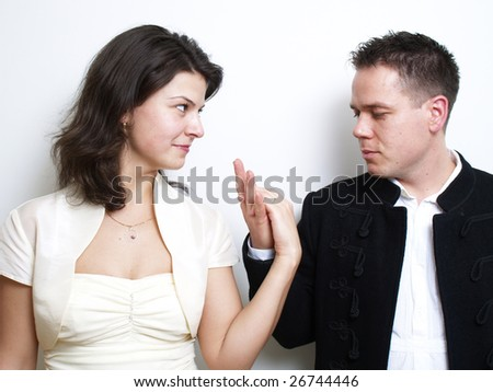 Young couple looking their ring