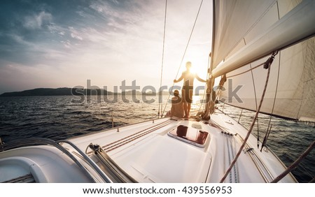 Young couple looking to the sunset on the yacht in Andaman sea