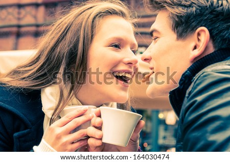 Young Couple lovely enjoying a cup of Coffee - stock photo