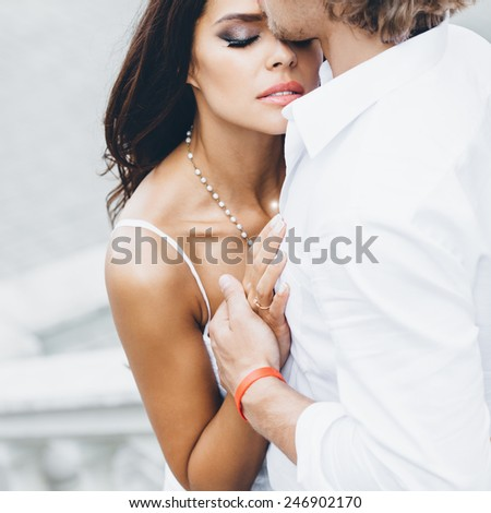 Young couple loving each other. Man kissing a woman. - stock photo