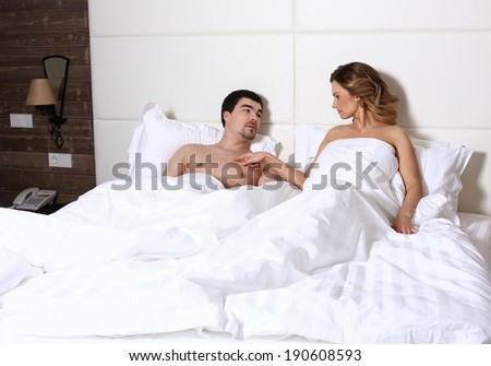 young couple lying in a bed