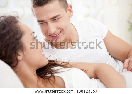 young couple lying in the bed