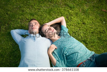 young couple lying on green moss , relax enjoying nature - stock photo