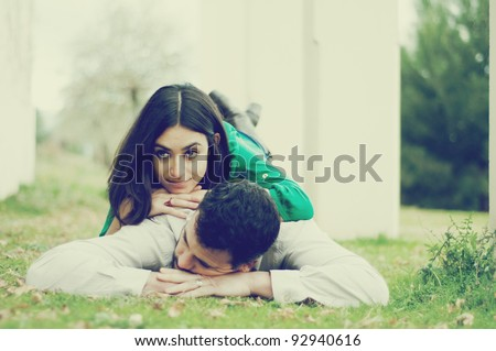 Young couple lying on the grass - stock photo