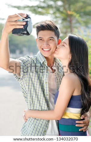 Young couple making a photo of them - stock photo