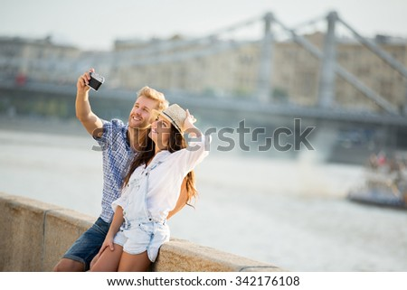 Young couple making selfie outdoors - stock photo