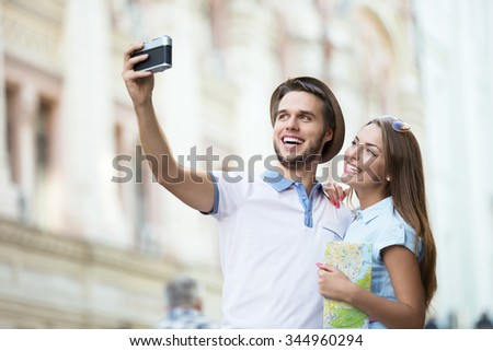 Young couple making selfie outdoors