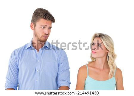 Young couple making silly faces on white background - stock photo