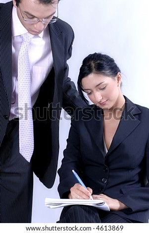 Young couple - man is explaining to woman while showing papers