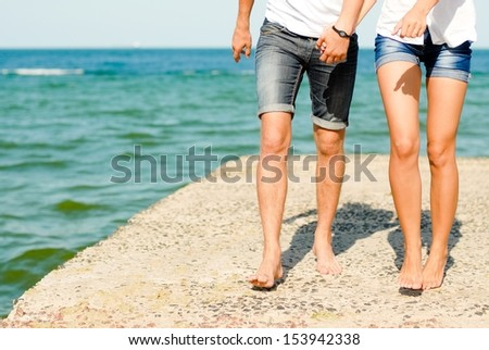 Young couple man & woman loving each other on sea in summer outdoors sea or ocean beach - stock photo