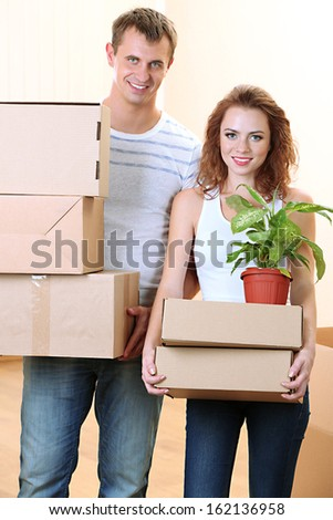 Young couple moves into new home - stock photo